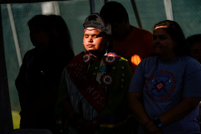 Young people from the Rosebud Sioux Tribe pray during a ceremony at the U.S. Army's Carlisle Barracks, in Carlisle, Pa., Wednesday, July 14, 2021.